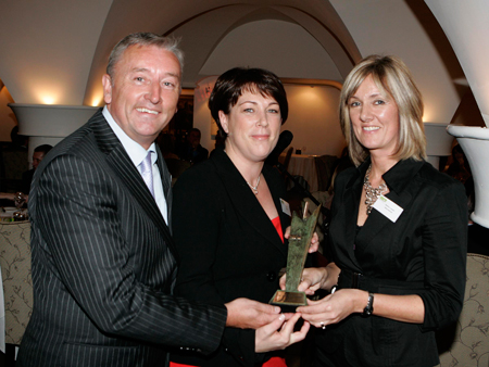 Winner Ruth Guy, Barnardos, receiving her award from Michael Cullen, editor, Marketing and Sandra Lawler, managing director, Alternatives